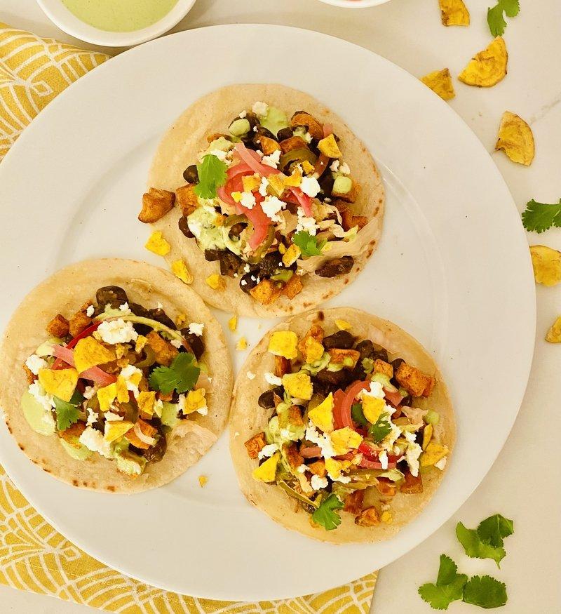Sweet Potato and Black Bean Tacos with Cilantro Tahini Crema