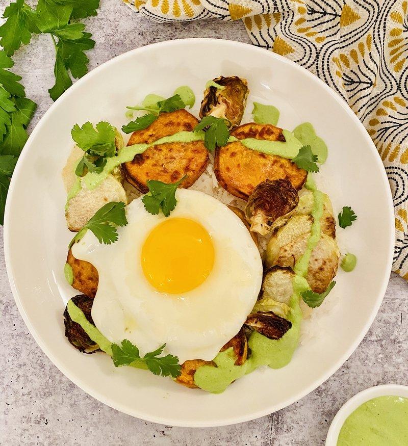 rice bowl with roasted veggies and green tahini
