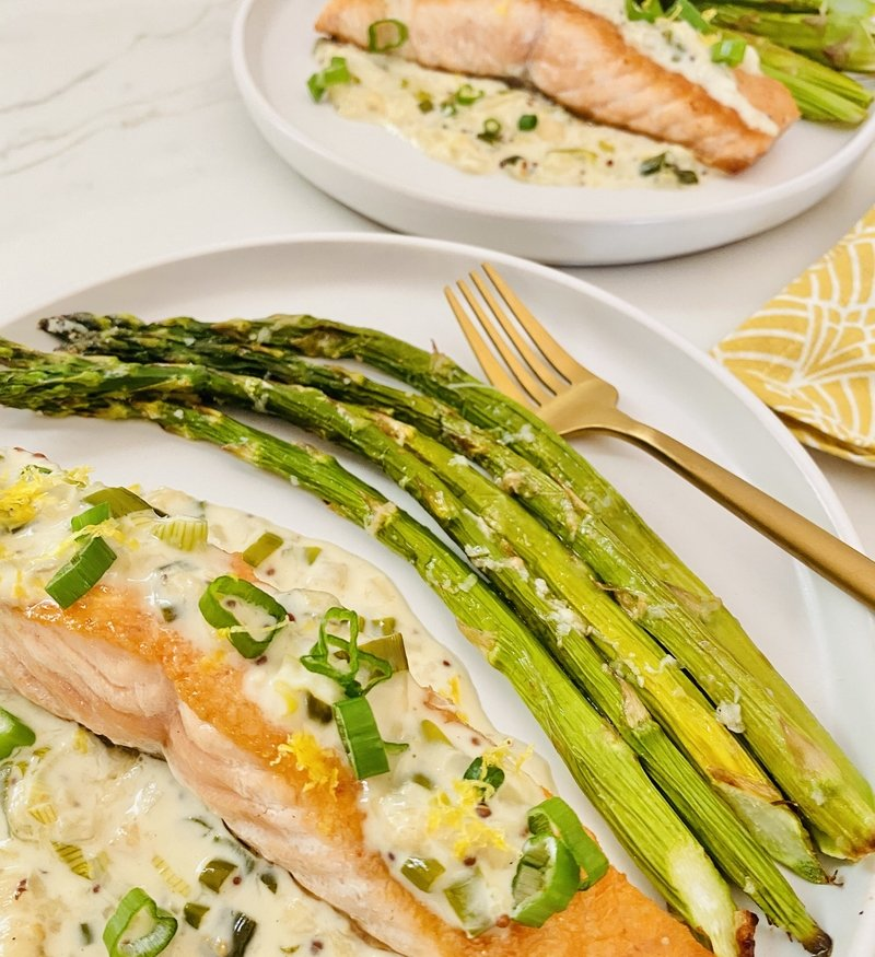 Pan Seared Salmon with Creamy Spring Scallion Sauce and Roasted Garlic Butter Asparagus