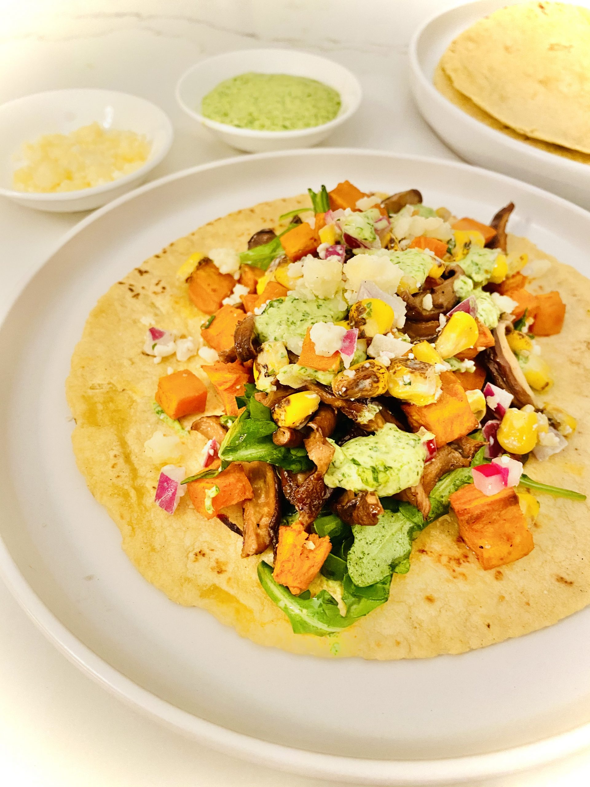 Sweet and spicy vegetarian shiitake bacon and roasted sweet potato tacos
